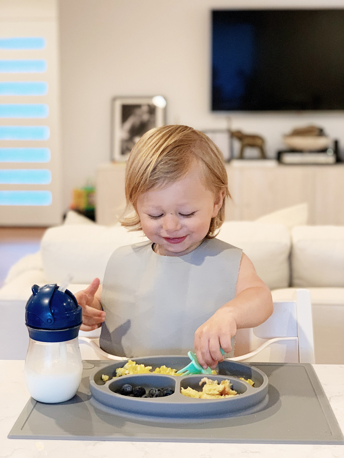 Toddler Feeding Essentials: 18 months featuring stokke tripp trapp highchair, ezpz mat, gathre bib, and oxo tot straw cup for eatsleepwear kimberly lapides