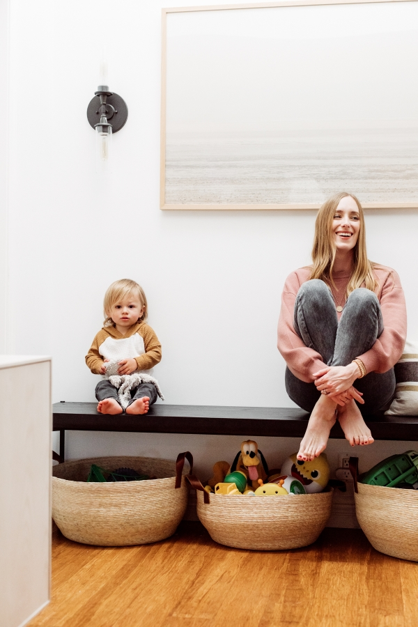 Mother and son sharing their toy organization by Kimberly Lapides of eatsleepwear