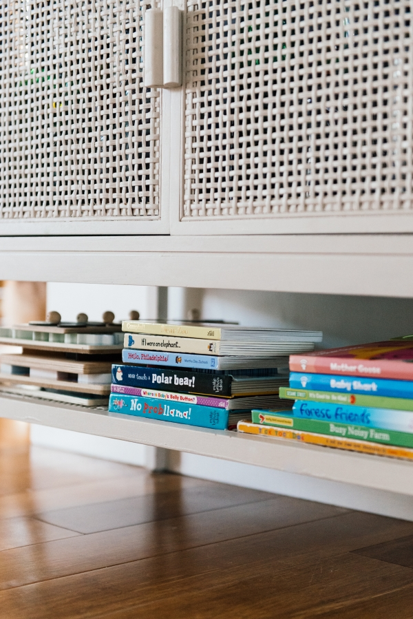 Tricks to hide your toddlers toys and books on shelves by Kimberly Lapides of eatsleepwear