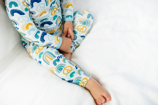 close up image of clover baby & kids rainbow print pajamas