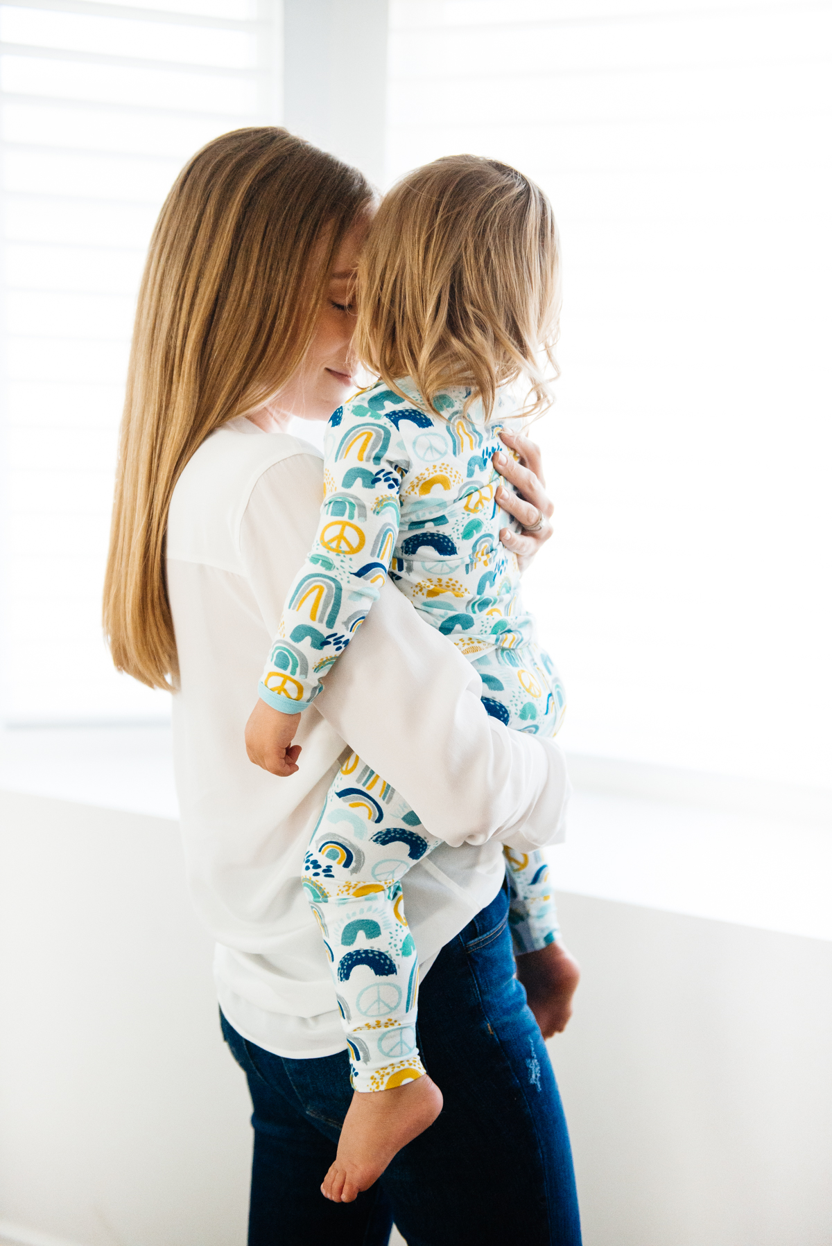 Kimberly Lapides of eatsleepwear and son in Clover Baby & Kids pajamas celebrating Rainbow Baby, IVF, and Infertility