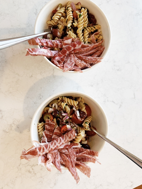 Easy lunch time cold pasta salad recipe with banza pasta with items from your pantry during quarantine by Kimberly Lapides of eatsleepwear