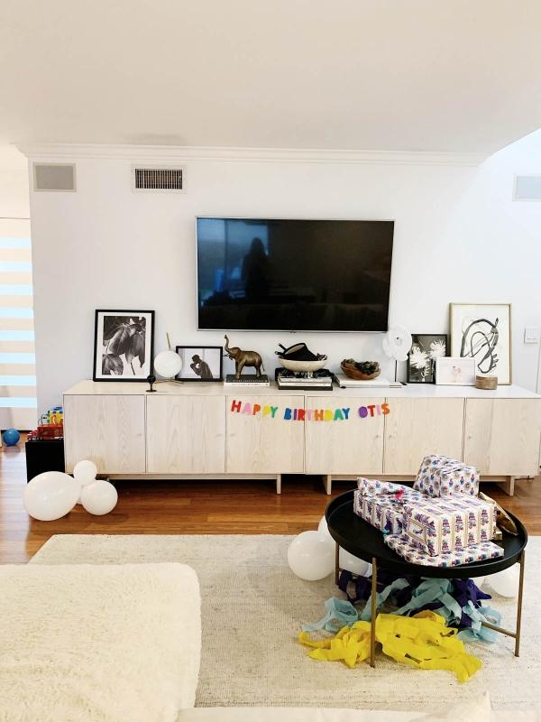 Trolls themed birthday decor showing a custom birthday banner and custom trolls wrapping paper