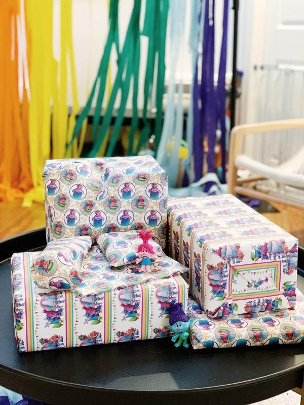 Trolls themed birthday decor showing  custom trolls wrapping paper
