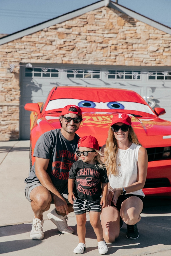 Posing for photo with Lightning McQueen Impersonator Car at Disney Pixar Cars themed birthday