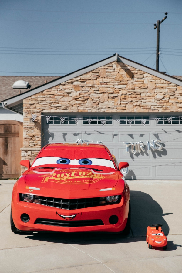 Lightning McQueen Impersonator Car and Ride on Lightning McQueen Car Toy at Disney Pixar Cars themed birthday