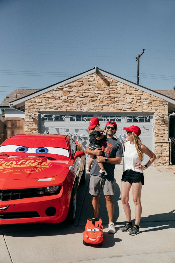 Family photos with Lightning McQueen Impersonator Car at Disney Pixar Cars themed birthday