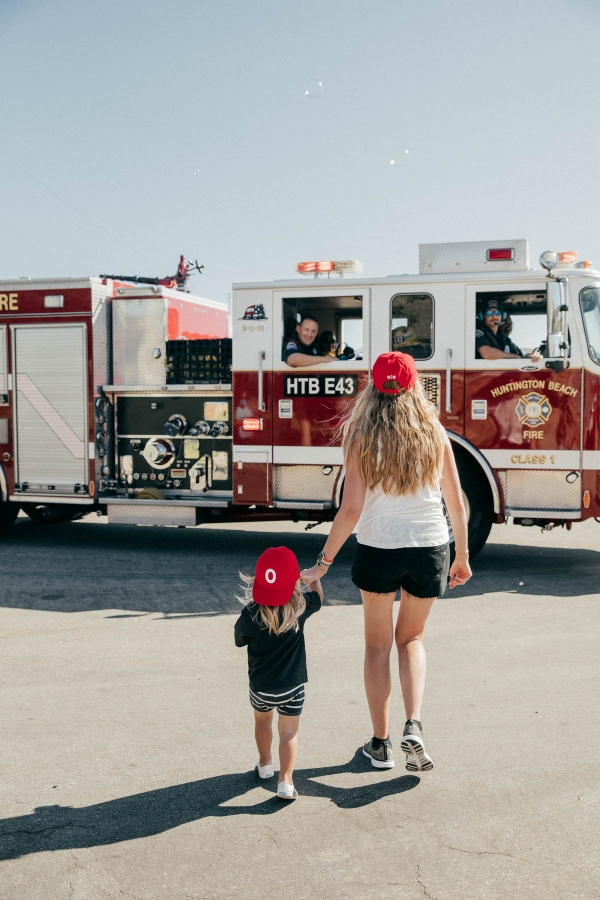 Mother and son walking to Firetruck at Disney Pixar Cars themed birthday