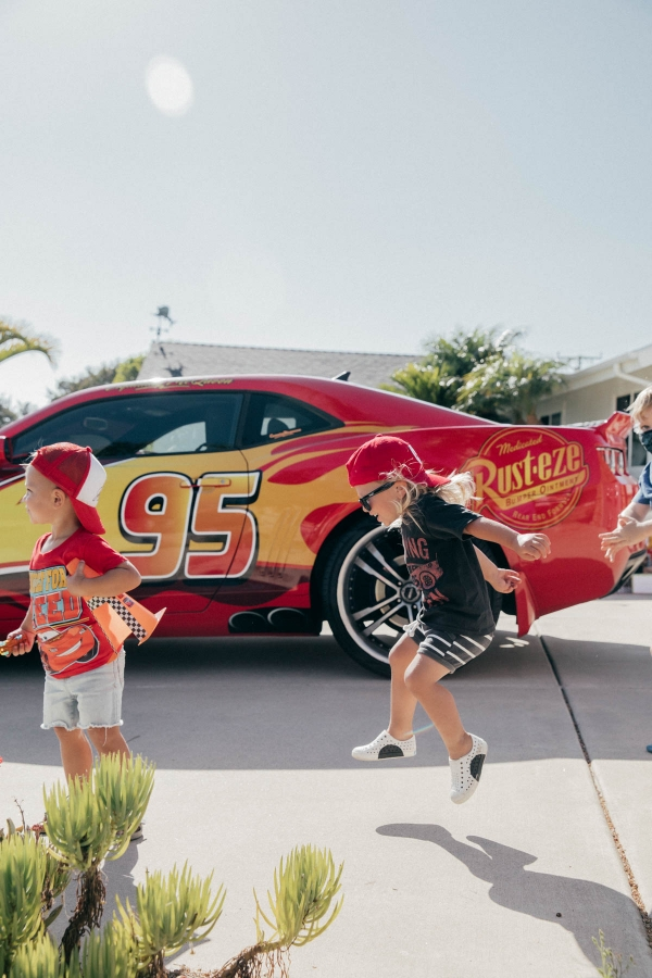 Toddlers dancing in front of Lightning McQueen Impersonator at Disney Pixar Cars themed birthday