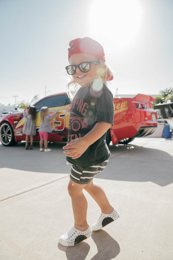 Toddler dancing in front of Lightning McQueen Impersonator at Disney Pixar Cars themed birthday