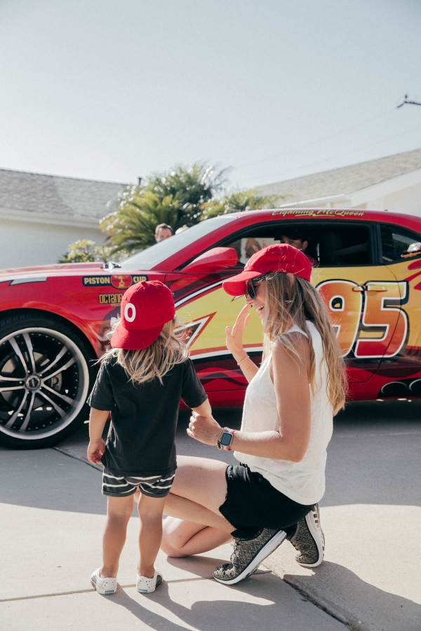 Mother and Son in front of Lightning McQueen Impersonator at Disney Pixar Cars themed birthday