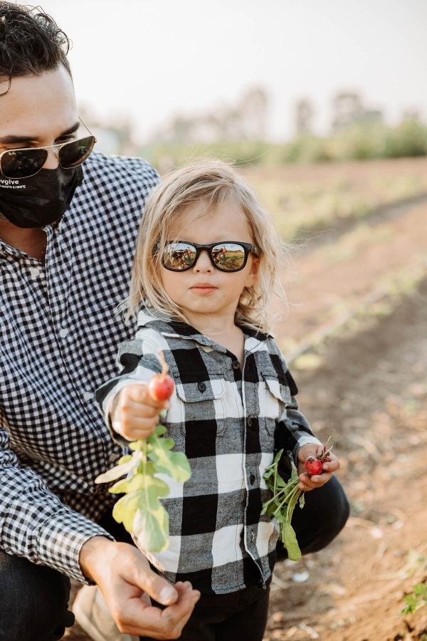 Vegetable picking at Hayride on tractor at Pumpkin Patch Photo shoot at Tanaka Farms