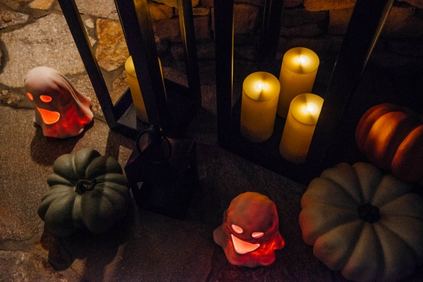 Fall & Halloween Decor For Patio & Yard with Lanterns, faux pumpkins, crow wreath and LED ghosts lit up at night