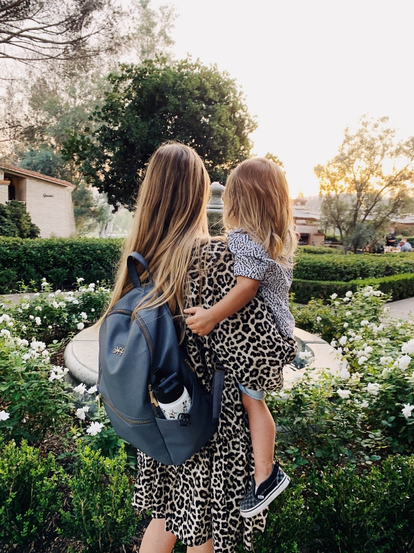 eatsleepwear goes on a family trip with toddler to Rancho Bernardo Inn showing mother and son at fountain