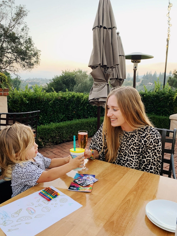 eatsleepwear goes on a family trip with toddler to Rancho Bernardo Inn showing mother and son at dinner outside