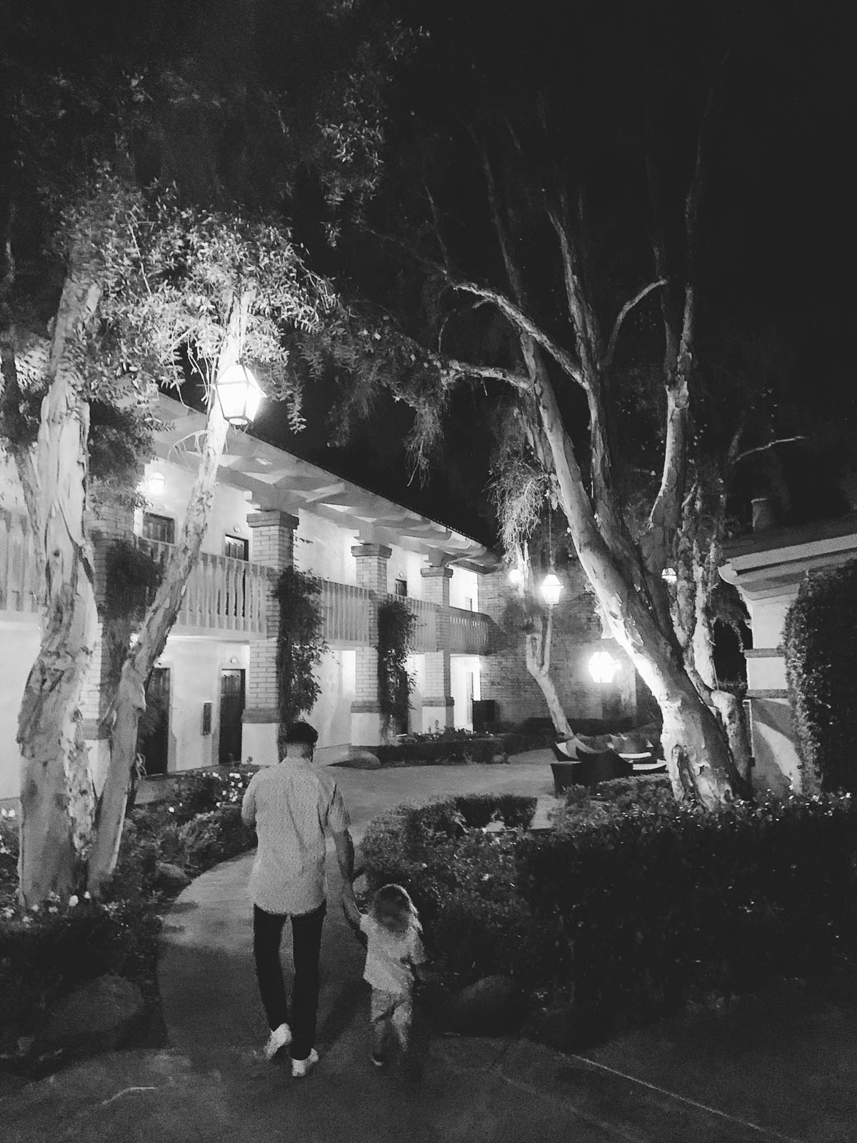 eatsleepwear goes on a family trip with toddler to Rancho Bernardo Inn showing father and son walking at night