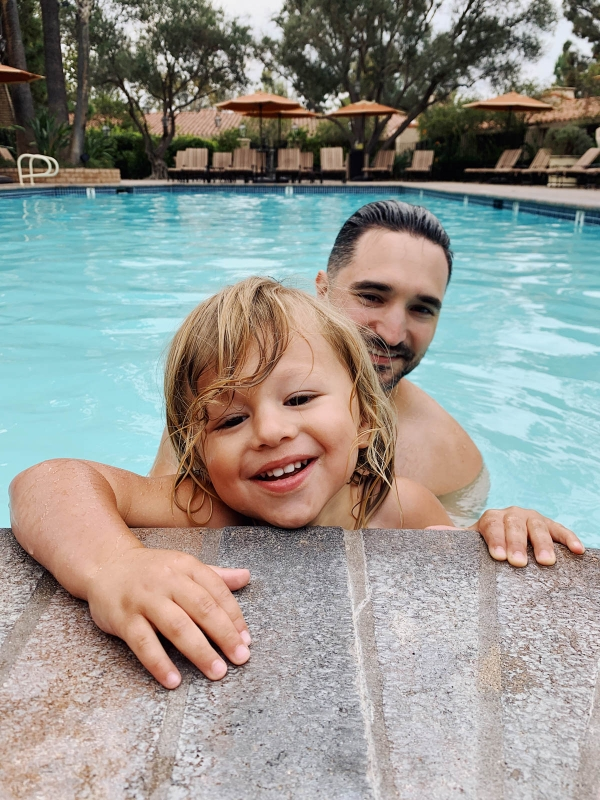 eatsleepwear goes on a family trip with toddler to Rancho Bernardo Inn showing father and son at the pool