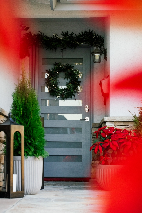 Outside Holiday Decor of wreath, garland and planted poinsettias