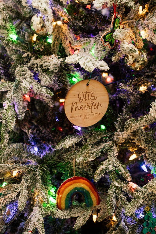 Indoor Holiday decor of lit Christmas tree and ornaments