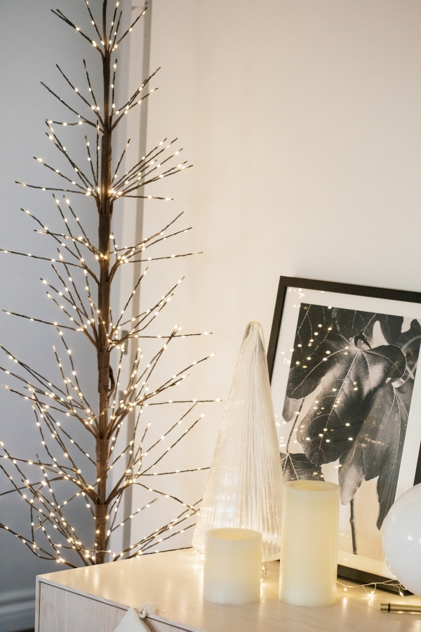 Indoor Holiday decor of twinkle lights tree, twinkle lights, clear glass Christmas tree cloche