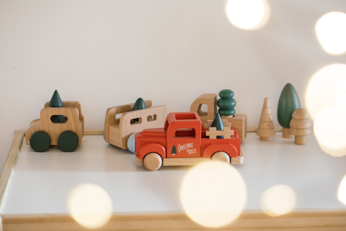 Indoor Holiday decor of kids Christmas truck toys