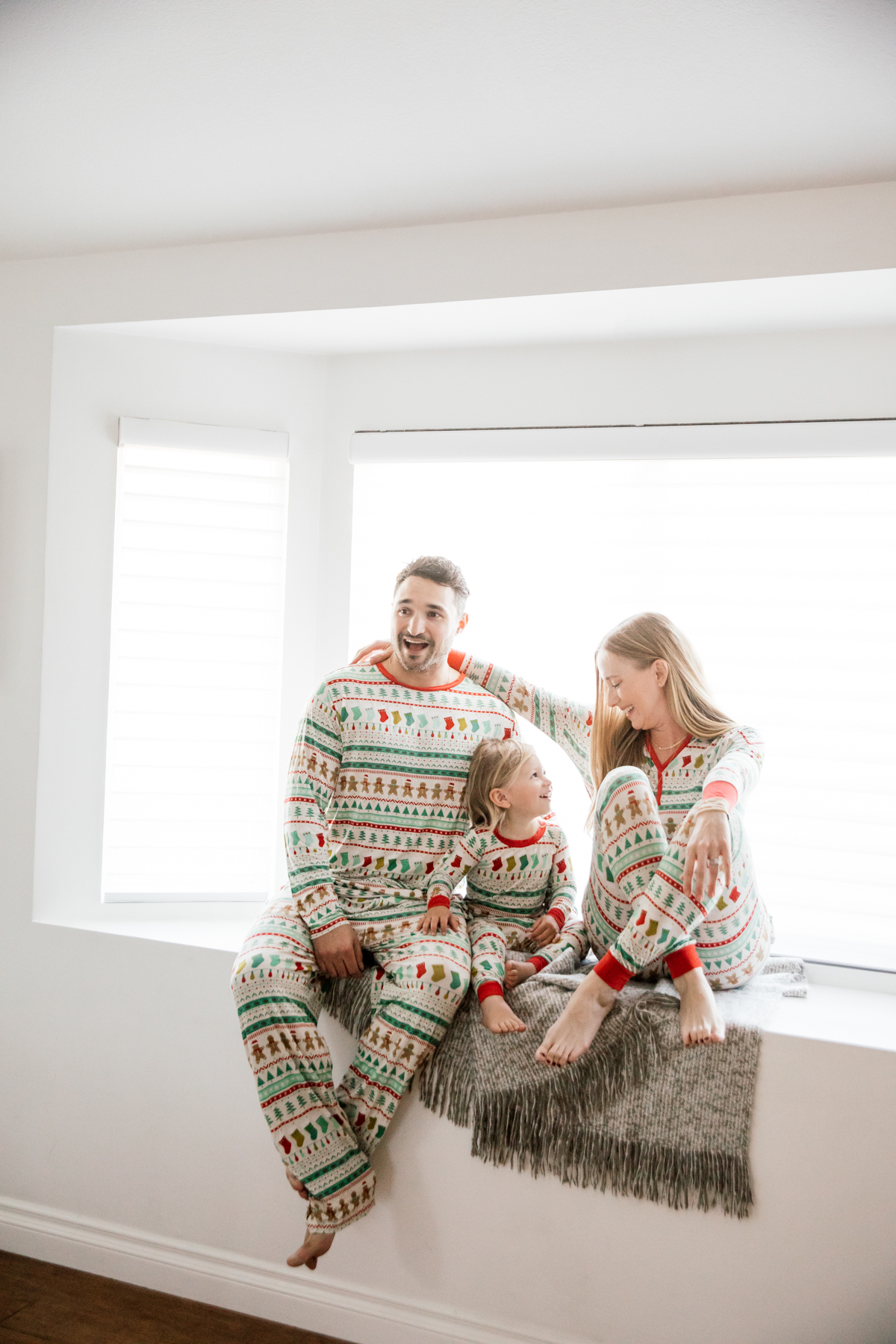 Family in matching Holiday pajamas