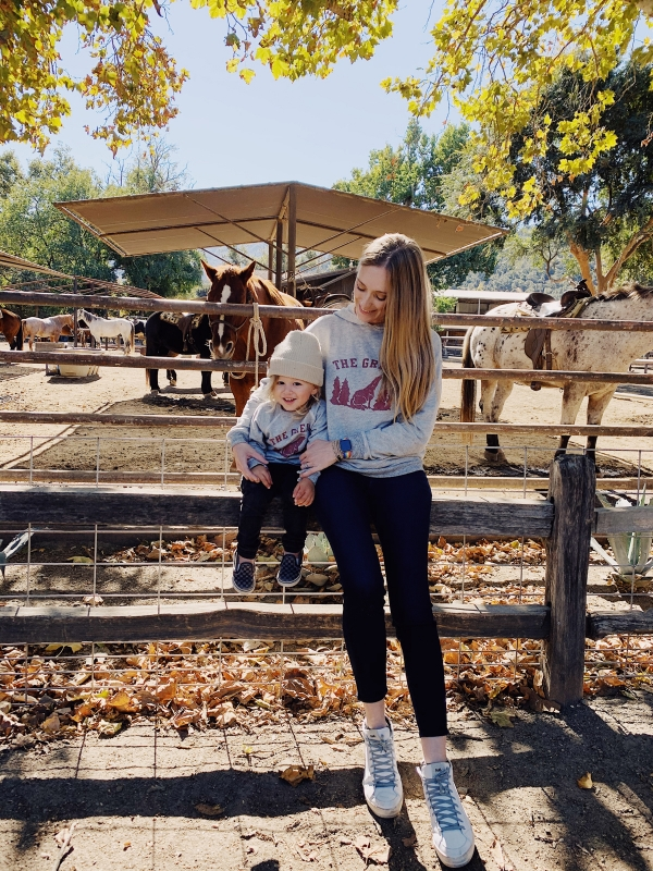 Mom and toddler in front of horses at Alisal Guest Ranch and Resort