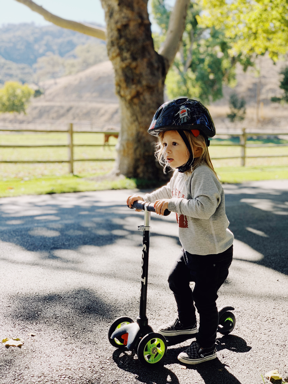 Toddler riding scooter at Alisal Guest Ranch and Resort