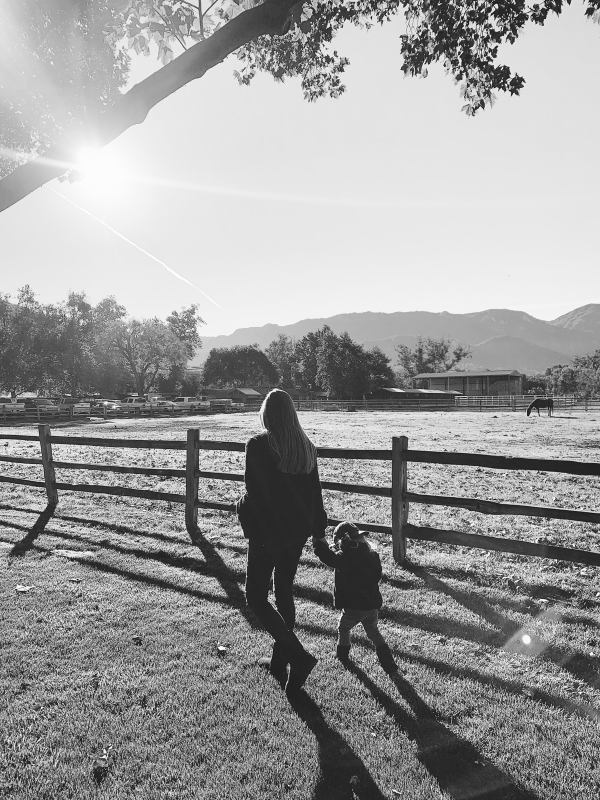 Mother and son walking by horses at Alisal Guest Ranch and Resort